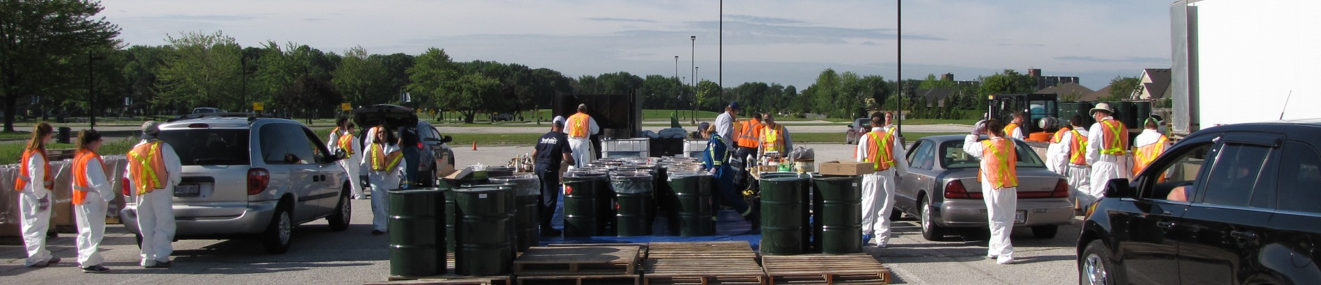 Residents dropping off items at mobile household hazardous waste depot