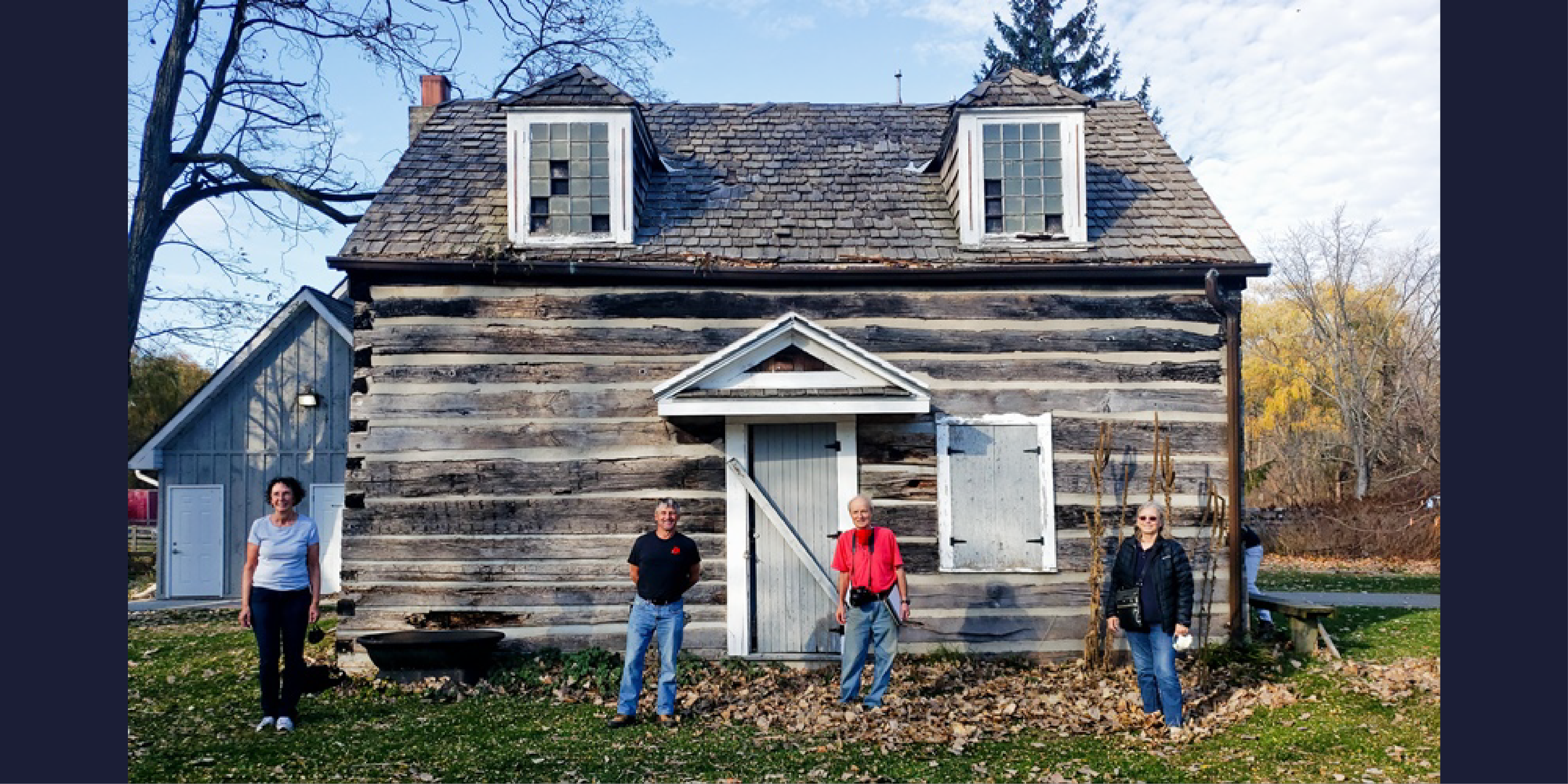 Volunteers standing in front of the cabin at Canatara Park