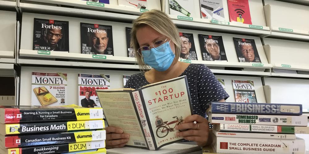 Library Technician Jillian Jakubowski researches small business topics at the Sarnia Library.