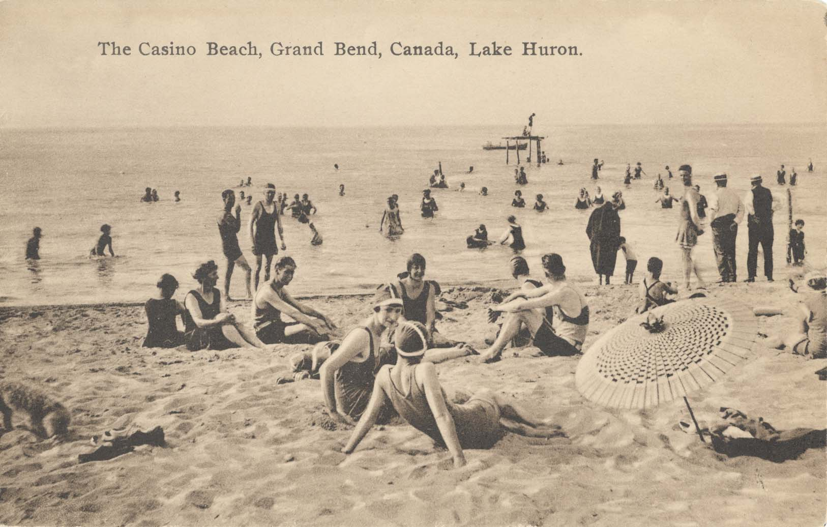 People enjoying time at the Grand Bend Beach in about 1920.