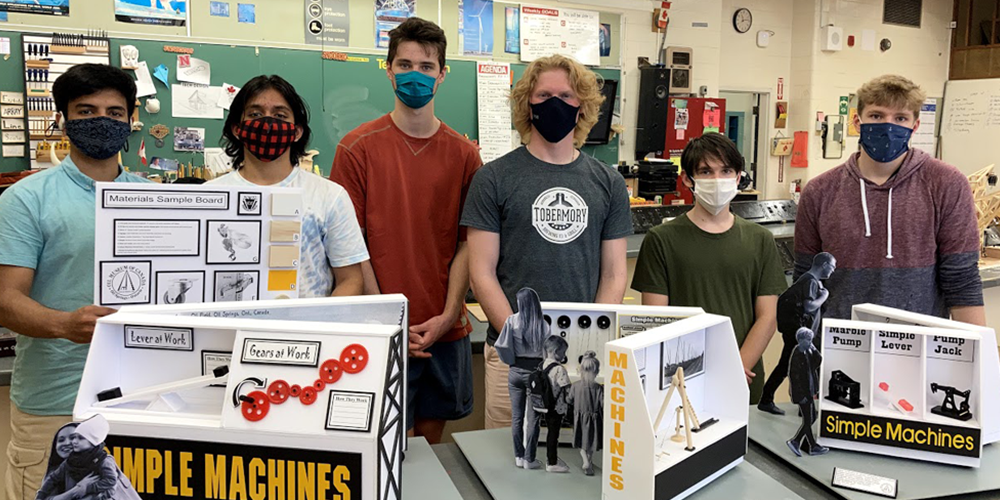 Northern Collegiate students standing with their project for the Oil Museum of Canada
