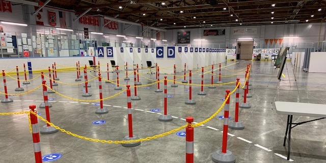 Rows of vaccinations pods and stanchions for line ups at the Point Edward Arena