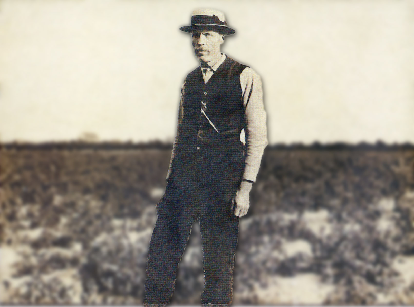 Historical photo of man standing in a field