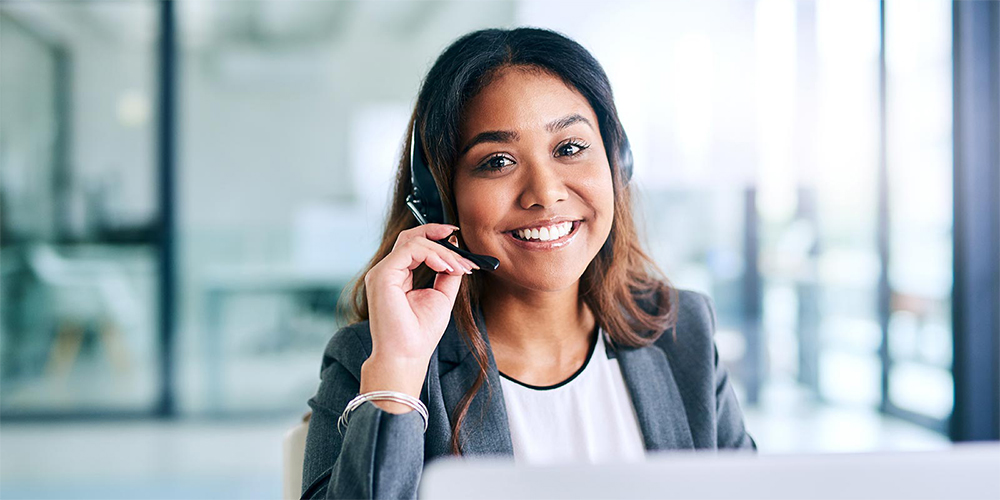 Woman wearing headset to answer calls in call centre