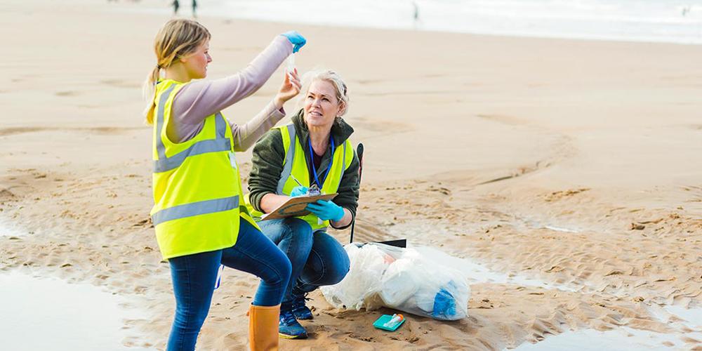 two women examining beach water samples