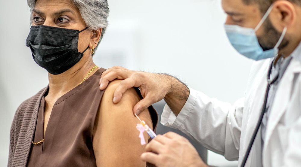 Woman gets COVID 19 vaccine